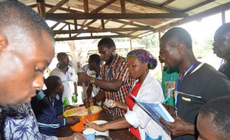 Picture of Ms Jacinta Ezurike showing participants how to make various value-added products.