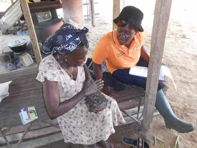 Picture of Lilian talking to a female participant in GREAT field activities in Cameroon.
