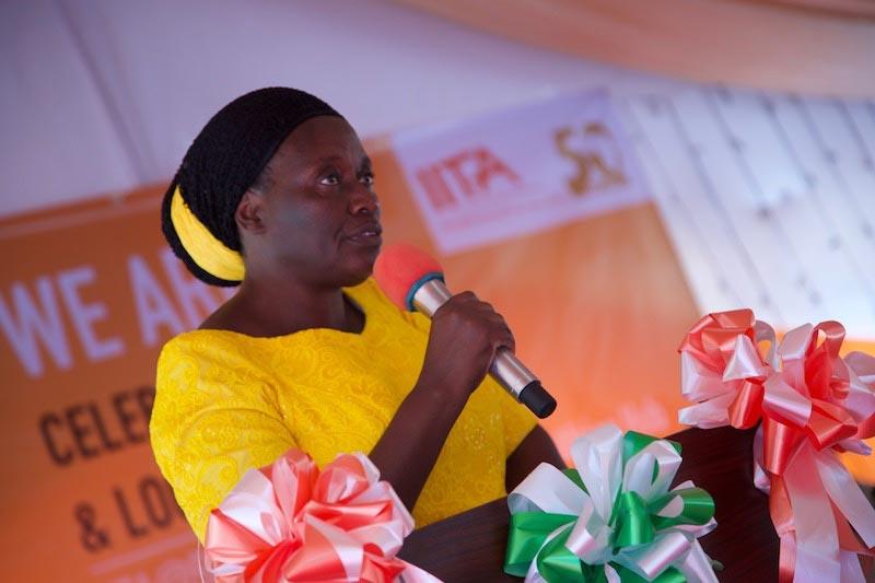Picture of Simkanga reading the Hon. Minister's speech.