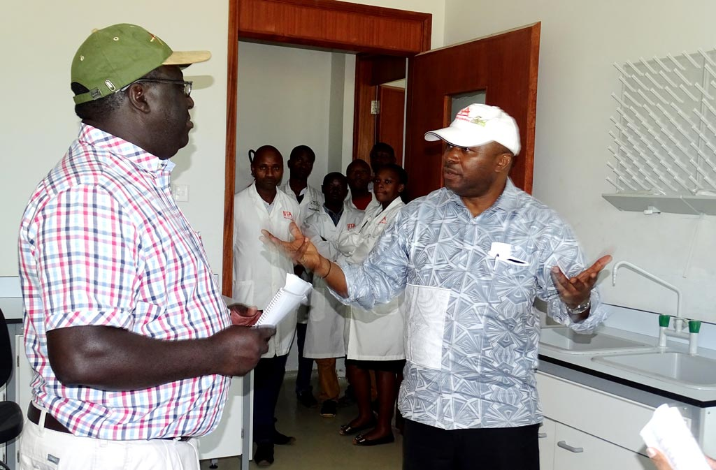 Picture of DG and Lawrence Kaptoge discussing the progress of construction during the visit.