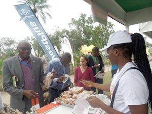 Picture of Guests and visitors looking at the various products produced by IYAKIN on display during the exhibition