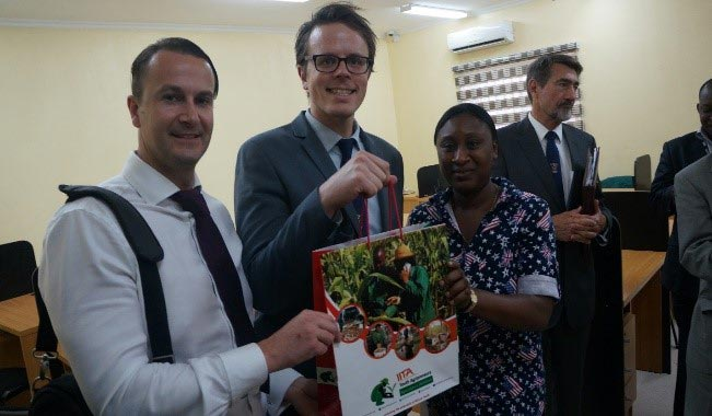 Picture of James Perrin, Regional Manager, Africa and Middle East receives gift from IYA member, Adetola Oladini.
