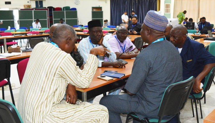 Picture of Maize seed health workshop participants in a discussion.