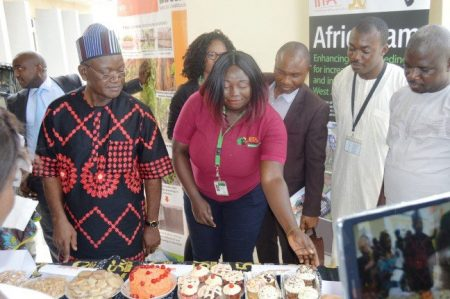 Picture of Governor at Agripreneurs' exhibition of cassava and yam products.