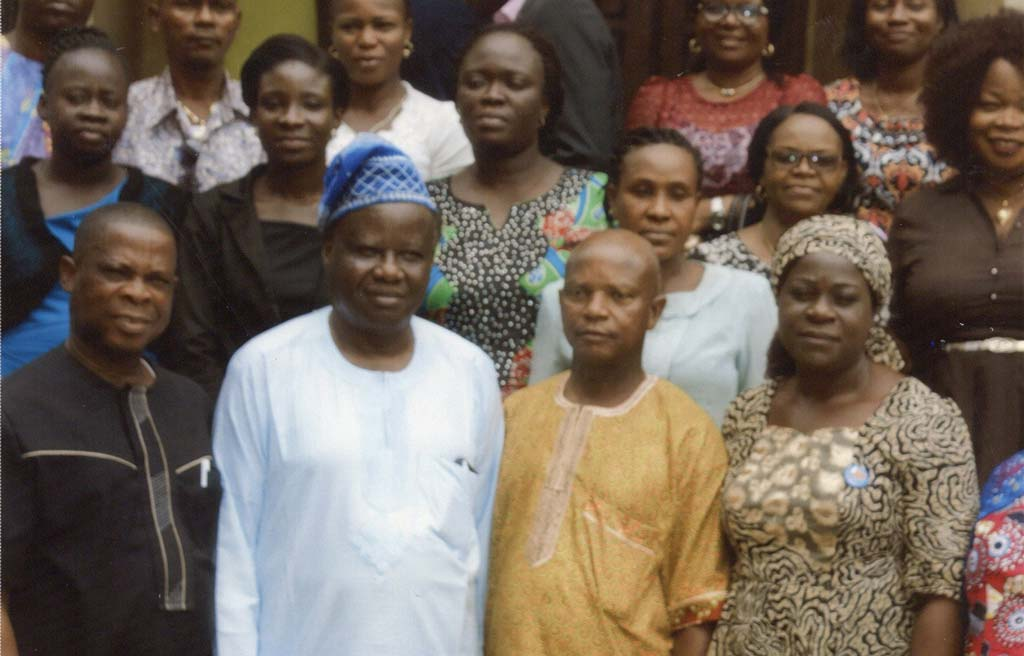 Picture of Librarian Louis Anajekwu with Prof Aina (wearing cap) and other delegates.