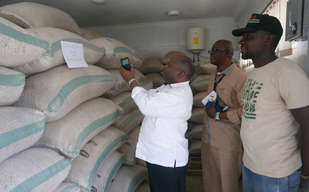 Picture of DG Sanginga at the IYA grain warehouse in Abuja.