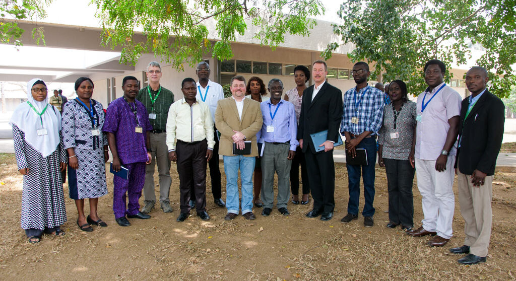 Picture of AgBiome representatives with some IITA staff led by Dr Robert Asiedu, middle (in blue long-sleeved shirt).
