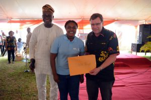 Excited star prize winner, Emily Iwu, flanked by MC, Wole Oladokun and BoT Chair, Bruce Coulman.