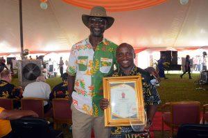 Outstanding General Staff award recipient, Sunday Ebere, with Kwesi Attah-Krah.
