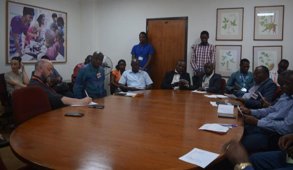 Picture of Officials of PAU discussing with Michael Abberton and IARSAF members in IITA's boardroom