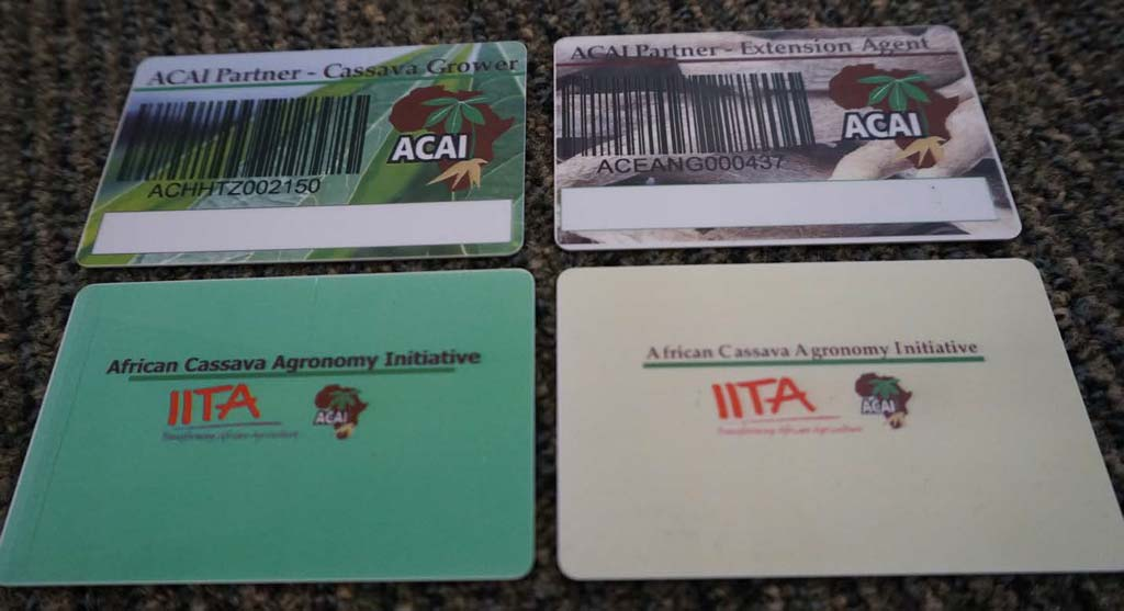 Picture of the ACAI ID cards being issued to Extension Agents and Cassava Growers