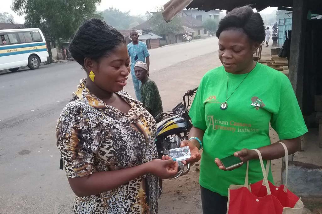 Picture of two women discussing ACAI ID card