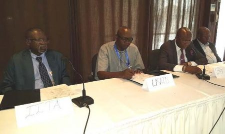 Picture of Dr Nzola Mahungu, Country Representative of IITA-DRC; Ir Augustin Kadima, delegate of USAID; Evariste Bushabu, General Secretary of the Ministry of Agriculture; Clement Kandu, Coordinator of SENASEM, at the workshop on CBSD.