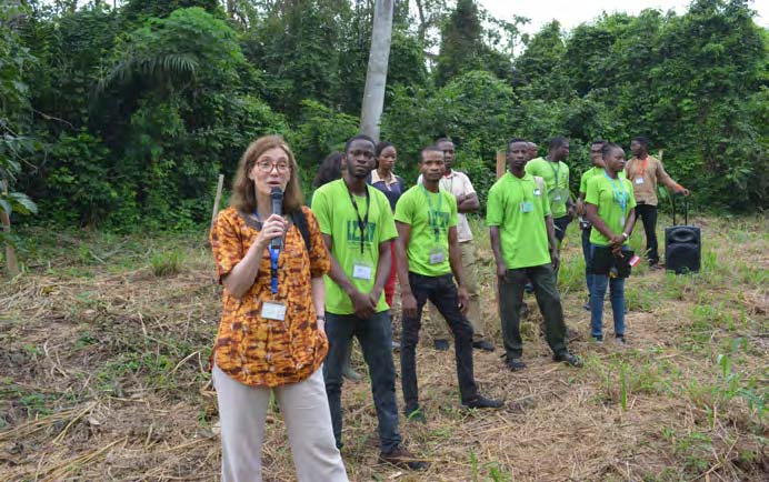Picture of Hilde Koper-Limbourg addressing the participants during the WMBD celebration at the Tree Heritage Park, IITA Ibadan
