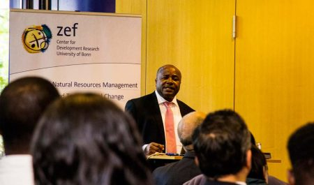 Picture of IITA Director General Nteranya Sanginga addressing Board members, German science and technology stakeholders, and other participants at a special session.