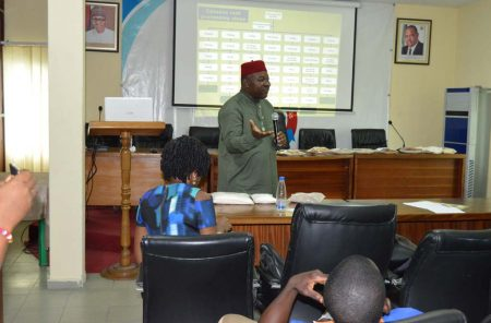 Picture of Richardson Okechukwu talking about agribusiness to the women and youth