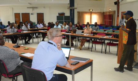 Picture of Tonny Omwansa, IITA Director, Research Support services, discussing and enlightening the participants.