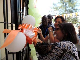 Picture of Leena Tripathi cutting the ribbon to officially commission the new FMS building in Dar es Salaam
