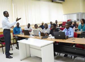 Picture of Dr Michael Olabisi explaining the use of R environment