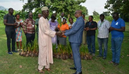Picture of Mallam Aminu Abubakar of FCTA presenting the coconut trees to the Head of Abuja Station, Dr Gbassey Tarawali