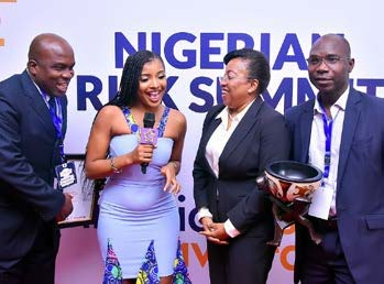 Picture of Jubilant IITA representatives talking to NRA moderator, L–R Kayode Awobajo, Sylvia Oyinlola, and Rasheed Fagbenro