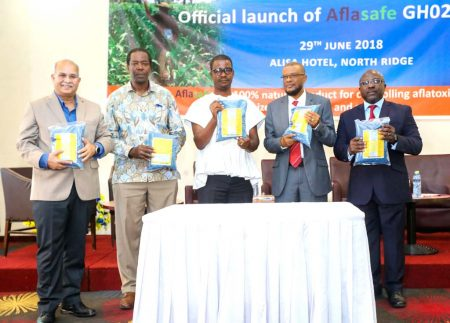 Picture of Research Leader of the Africa-wide Aflasafe Initiative at IITA, Ranajit Bandyopadhyay (left),with Abdou Konlambigue of ATTC (rightmost) and other dignitaries showing off packs of Aflasafe GH02 at its launch in Accra.