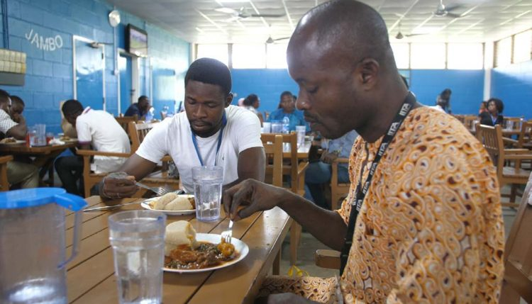 Picture of staff members enjoying their lunch at the IITA staff canteen