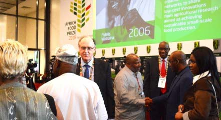 Picture of DG Nteranya Sanginga being congratulated by AGRF participants