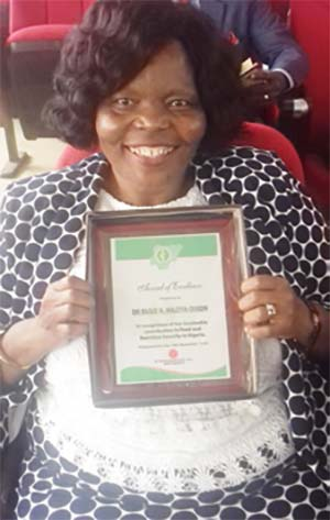 Picture of Dr Busie Maziya-Dixon showing off her plaque