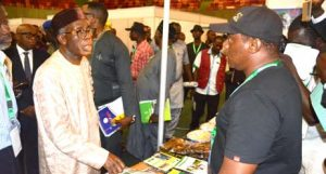 Picture of Minister of Agriculture, Chief Audu Ogbeh, visiting the IITA stand