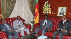 Picture of thje TAAT leadership in a discussion with the country officials