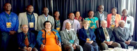 Picture of Francis Onyilo, IITA PhD student, (3rd from left, on the second line) with other selected felleows and the WFP organizers