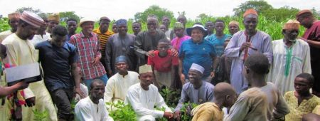 Group photograph of Seed System Specialists and farmers appreciating their high yield