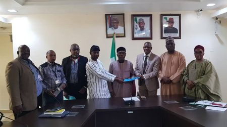 IITA team with Minister of Agriculture, Chief Audu Ogbeh (center) and officials of Origin Group Nigeria at the signing ceremony.