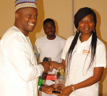Sore receives award of recognition presented to IITA by the University.