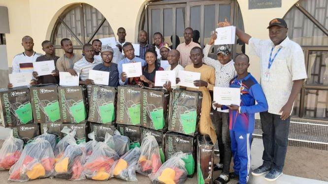 Adamawa State participants with training facilitators behind.