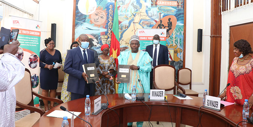 Displaying the signed agreements: Cargele Masso, IITA Country Representative in Cameroon (left) and Honorable Mbairobe Gabriel, Minister of Agriculture and Rural Development.