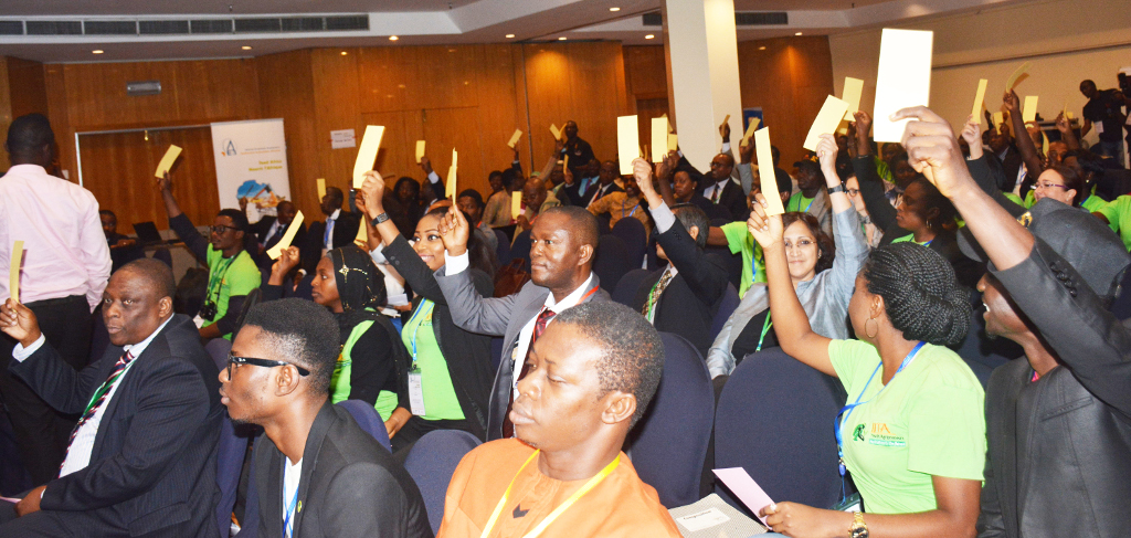 Picture of Participants cast their votes during the debate.